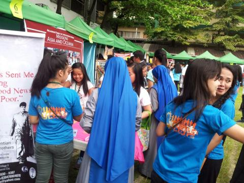 Youth from our parish (in blue T-shirts) helping promoting our booth