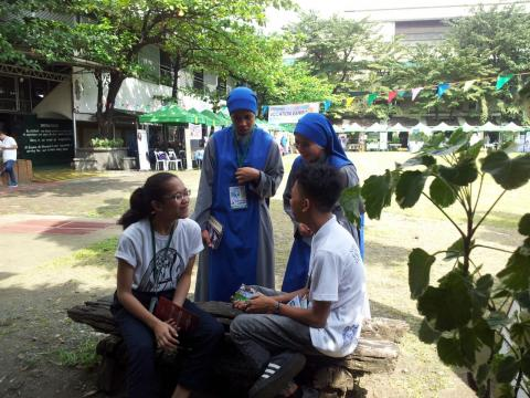 Sisters chatting with youth met at the event