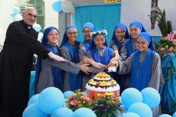 The Religious Family of the Incarnate Word cut the 'wedding cake' at the beginning of the lunch celebration