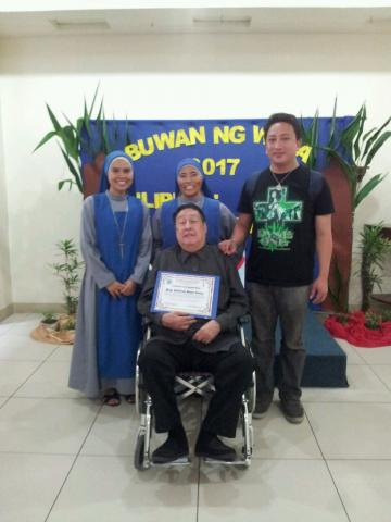 group picture of our sisters and our guest judge of buwan ng wika, Mr Guillermo Gómez Rivera