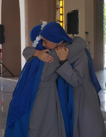 Provincial Superior embracing the newly professed