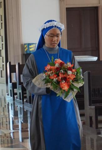 the newly professed offered flower to our Lady