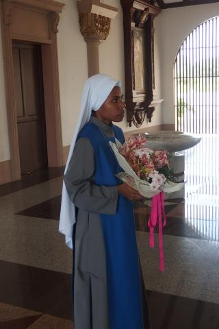 novice offered flowers to Our Lady