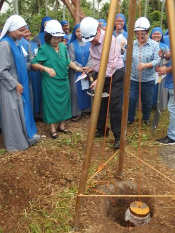 A benefactor of our construction project participated in the unearthing of the first soil