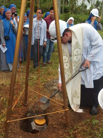 Fr. Soler unearth the first soil from the site